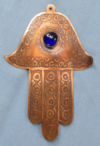 RAWs-Jain-Symbol-copper-with-blue-glass